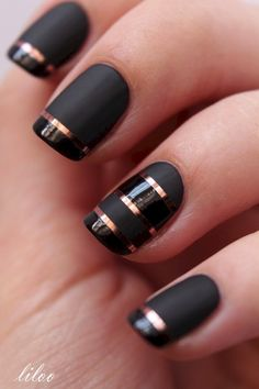 Matte and glossy French nails with striping tape.