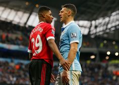 Martin Demichelis clashes with Marcus Rashford