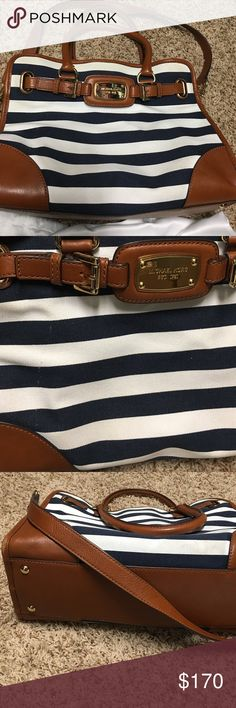 Michael Kors Nautical Stripe Bag Striped nautical bag (Hamilton??) hardware good no scratches. Inside VERY clean. Front canvas has light pick in material seen in the picture. Bottom has light mark in canvas and leather at bottom has small wear. Still VERY New looking as these items are minor but want to make full disclosure it's used and not perfect. Dust bag included! Ask any questions!!  14.5x9 Size Michael Kors Bags Satchels