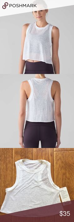 """LULULEMON SIZE 4 HINT OF SHEET CROPPED TANK WHITE SUPER CUTE LULULEMON """"HINT OF SHEER"""" CROPPED TANK IN WHITE SIZE 4. GOOD CONDITION- VERY LIGHTLY WORN! CONES WITH ORIGINAL HANG TAG. ***Slip on this soft, lightweight tank to cool down in post-practice, and savour its airy coziness for the rest of your day. The high neck and back let you enjoy soft, breathable coverage on your skin, while the deep armholes and relaxed fit allow airflow on hot days. And don't worry about slipping straps, this…"""