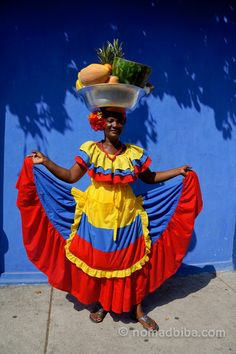 One of the most iconic characters you'll see in Cartagena de Indias (Colombia) are the smiling palenqueras — those ladies dressed in colourful outfits who balance a bowl of fresh fruits on their heads. South America Destinations, South America Travel, Colombian Culture, Colombia Travel, Iconic Characters, Colourful Outfits, Beautiful World, Caribbean, Traditional Dresses
