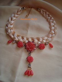 Short knitted necklace with silk cord and coral flowers  https://www.facebook.com/pages/Handmade-Creations-by-Efi/187659788043676?ref_type=bookmark