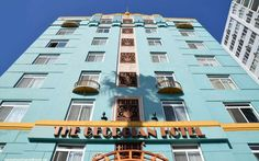 The Georgian Hotel sticks out like a sore thumb due to it's bright blue color…