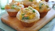 Chicken Pot Pie Cupcakes: Two cans of Pillsbury biscuits, a cup of cooked and diced chicken breast, one can of cream of chicken soup, some shredded cheddar, frozen mixed veggies (Green Giant Valley Fresh Steamers frozen mixed veggies work great, or use your choice!), some Herbs De Provence, onion powder and garlic salt. Press  biscuits into a muffin tin SPOON IN THE FILLING AND BAKE FOR 15 MINUTES