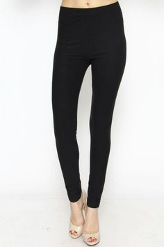 "solid basic leggings - black | every girl needs a basic pair of leggings! these solid brushed leggings are comfortable and easily dressed up or down. runs true to size. model is a small. length: 34.5"" inseam: 26"" 92% polyester, 8% spandex 