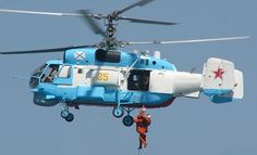 Russian navy Kamov  (NATO code-named Helix)  Ka-32 features a co-axial rotor system with tail boom instead of tail rotor giving it great stability.