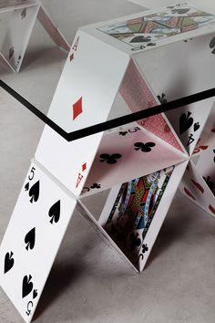 'house of cards table' by maurício arruda is a functional furniture object based off the game of building a structure out of playing cards.