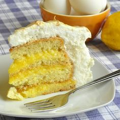 Lemon Meringue Cake - such a wonderfully light cake with a really intense tangy lemon flavor in the curd that fills this cake. If you prefer a lighter lemon flavor, just reduce or omit the lemon zest to suit your own taste.