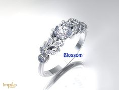 """""""Blossom"""" - This stunning engagement ring has one round brilliant cut diamond centre stone with six diamonds on each side in the leaf pattern. First Round, Diamond Engagement Rings, Stone, Centre, Pattern, Diamonds, Collection, Jewelry, Rock"""