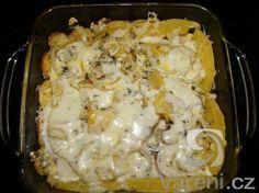 Chutná zapečená dýně s brambory, rajčaty, cibulí a nivou. Recept na výbornou přílohu k různým pokrmům nebo samostatný předkrm.