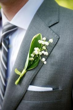 A lovely, Lily of the Valley boutonniere   Brides.com