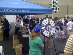 Fifth Third Bank and their prize wheel was a big hit at our Fan Day! Buy this Prize Wheel at http://PrizeWheel.com/products/floor-prize-wheels/floor-table-black-clicker-prize-wheel-18-slot/.