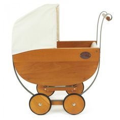 Moulin Roty Wooden & Metal Pram Toy, $196. Find this and more Gift Guides at SmallforBig.com #kids #toys #holidays