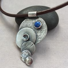 Contemporary Silver Pendant on a leather choker.
