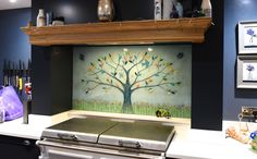 This latest example of our fused glass kitchen splashbacks found a home in a kitchen in Elie and Earlsferry, Fife. It's a Tree of Life that sports a beautifully neutral blue stone colour that's full of subtle texture. On top of that, the trunk of the tree itself is created line by line. Each leaf you see was cut by hand and carefully picked from a wide range of complementary colours. Subtle Textures, Splashback, Fused Glass Art, Panel Art, Glass Kitchen, Finding A House, All Design, Colours, Architecture