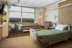 """The move to single patient rooms was a given as far as Gundersen's Kari Houser was concerned. """"Sharing a hospital room is just not within today's consumer-driven framework,"""" she says. The rooms feature sizable windows to show off the surrounding valley views. Photo: AECOM"""