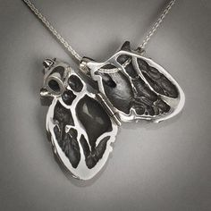 Silver Anatomical Heart Locket by PeggySkempJewelry on Etsy