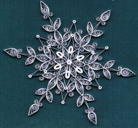 Delicate Quilled DIY Paper Snowflakes