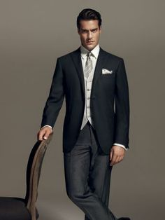 Straight morning dress in wool and shiny micro-effect silk, peak lapels, slate grey with pearl grey waistcoat. Striped trousers without pleats, 20 cm base. #formalwear13 #men
