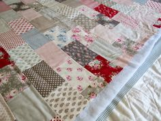 A Little Happy Place: How I made my Tilda Brick Quilt: previously, I used lots and lots of safety pins to bast the layers together, starting from the centre and working outwards, smoothing the layers as you go.  However since the last big quilt, I discovered 505 spray and I have been using it for all my mini quilts.  So I decided to throw caution to the wind and use it for this project.  From experience, I found I have had best results if I sprayed the wadding rather than the fabric....
