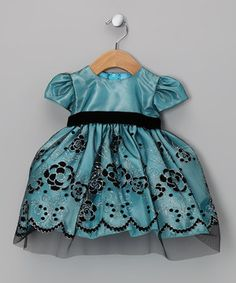 Perfect for a pretty party look, this darling dress features a satin bodice, velvet waist and gorgeous, glittering embroidery across the skirt. With lovely lining and a zippered back, this fabulous frock will dazzle on any precious princess.