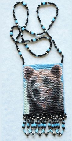 """Bear pattern in peyote stitch from the book """"Spirit of the West: Amulet Bags n Peyote Stitch"""" by Sheila Root"""