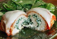 Baked chicken breasts rolled with spinach and ricotta topped with pomodoro sauce and melted mozzarella. A dish the whole family will love! Since making chicken rollatini stuffed with prosciutto and cheese a few weeks back my husband has been craving chicken rollatini the way he grew up eating it, stuffed with cheese and topped with sauce and more cheese. I had to sneak some spinach in them against his will, but he was very pleased with the final results. I guess you can say this is a cross…