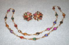Vintage Multi Color Rhinestone Floral Clip On Earrings & Necklace by Izzyoma on Etsy