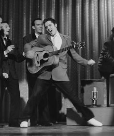 Elvis shaking. (I remember his first appearance on the Ed Sullivan show, they wouldn't show him shaking from waste down on TV. But that's what we wanted to see!