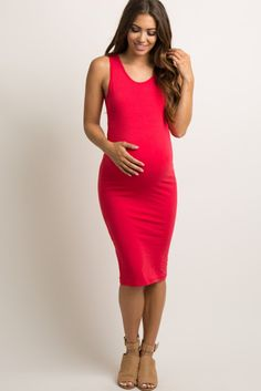 970d5a464d23d A solid hued, fitted maternity dress featuring a rounded neckline and a  sleeveless style.