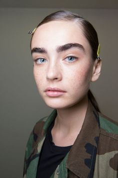 Laboriously laboured over skin, meticulously brushed up brows, a wiggle of brown mascara in the roots of lashes - all the things that make for a well-groomed but equally natural make-up look. 'You have to take extra care with no make-up make-up,' Pat McGrath told us backstage; 'we're spending around 30 minutes on each model.'