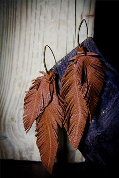 Leather Feather brown  Earrings in Lambskin and fringe with custom ear wires. $50.00, via Etsy.
