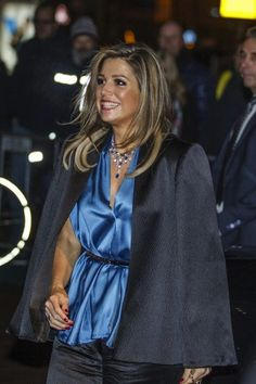 The queen in a blue silk top. Click on the image to see more looks.