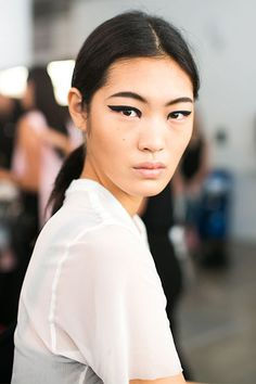 "The Only Makeup Looks You Need To See From NYFW #refinery29  http://www.refinery29.com/best-makeup-nyfw-spring-2015#slide12  Queen of Extremes ""I imagined Cleopatra in the Hamptons,"" Yadim says of the look he dreamt up for Cushnie et Ochs's summer-glam woman. ""It's a really exaggerated liner look, but it's not a cat-eye because it's kept completely straight. There's almost a punk feeling to the shape."" The key to making it work? ""Mimic the structure of the liner in the eyebrows,"" he says…"