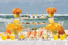 Vibrant orange and yellow decorations for a beach wedding