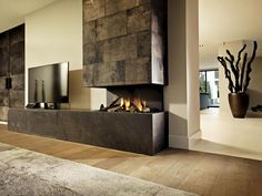 Danils fireplaces - Fireplace, including a TV, piece of Furniture covered in leather, Highly Exclusive, living room and garden are an inspiration. Furniture, Home Room Design, Interior, Home, Modern Tv Wall Units, Modern Living Room Interior, Tv Furniture, Furniture Covers, Fireplace