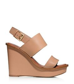 Our Lexington Wedge is a quintessential city sandal. Modern and architectural, it combines wide banded leather straps with a sculpted platform and heel. It adds major leg-lengthening height without sa