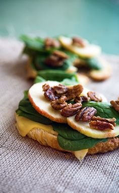 GOUDA APPLE CROISSANT~ 1 large croissant, 2 slices of Gouda cheese, ⅓ cup baby spinach, ½ Gala apple cored and sliced, 2-3 tbsp candied pecans or walnuts.