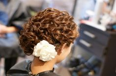 make a low bun leave top layer out, then pin curls around for an elegant look