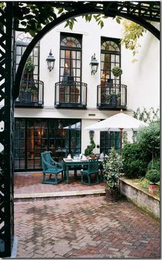 lovely courtyard setting-I would love a holiday here, wherever it is.