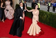 Dita Von Teese high fives Zac Posen, whose design she wore, outside the Metropolitan Museum of Art