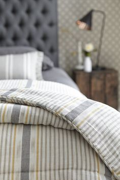 This is a new type of quilt which has been made up in Vanessa's NEW Lapland Stripe woven fabric in colourway Dove, Saffron & Charcoal