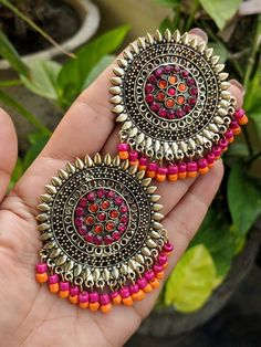 These glass stones studded Afghani earrings are worth drooling for and a must have in every girls and womens closet,Pair them up with any formal or casual attire for that striking look. Extremely lightweight these earrings are comfortable to wear even for long hours! Weight 34 gm Length 2.2 inches