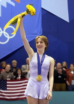 Sarah Hughes of the United States acknowledges the cheers after unexpectedly winning the women's figure skating gold medal at the Delta Center.
