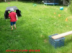Outdoor Obstacle Course, easy enough for a toddler, but fun for older kids, too.  Features raised balance beam, jumping over/between sticks, and bouncing on a ball.
