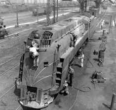 Overhead photo showing a Chicago And North Western streamlined Class locomotive having maintenance performed. Time Travel Machine, Train Times, Railroad Photography, Train Art, Old Trains, Train Pictures, Train Engines, Model Train Layouts, Steam Engine