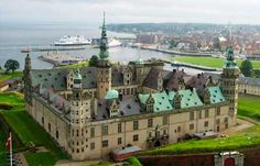 """""""Kronborg Castle"""", Danish Folk Art Museum,Denmark . Kronborg was originally built in the 1420's by King Eric of Denmark, Sweden and Norway. It is located in Helsingør and was used as a royal residence and fortress until the 1720's. It is today only used as a MUSEUM. Kronborg is the castle known from Shakespeare's """"Hamlet""""."""