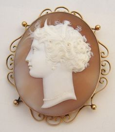 "LARGE ANTIQUE SHELL CAMEO 9K GOLD BROOCH: A terrific late 19th century circa 1880 - 1890 hand carved shell Cameo Brooch depicting the profile portrait of a beautiful classical female head.            The cameo is set into a fine 9ct yellow gold frame with scroll and globe decoration around the edge. Original gold pin and ""c"" clasp are both in excellent working condition. Marked 9CT.            Dimensions: The brooch measures 2 3/8 inches x 2 1/8 inches. 