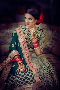 Indian wedding photography. Bridal photo shoot ideas. Indian bride wearing bridal lehenga and jewelry. #IndianBridalHairstyle #IndianBridalMakeup #IndianBridalFashion Photo by Deo Studios