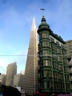 Sharing Spaces.  The photo's angle and the local terrain makes it seem like an old structure stands shoulder to shoulder with the Trans America Pyramid